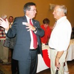 Ken Cooley chats with Dick Parsons with the Four Seasons Civic League. The league hosted last Thursday's debate. Village Life photo by Noel Stack