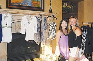 Katie Hicks and Ashley Lowe pose with the goods at the Buy-A-Day Boutique. Courtesy photo