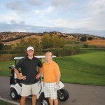 Golfers Steve Carissimi and Pete Kreuser take a break during