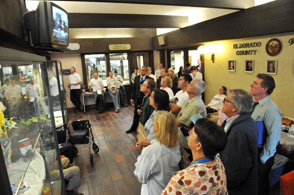 AN OVERFLOW crowd at the El Dorado County Board of Supervisors Monday waits to hear grim news about which programs will fall victim to the budget ax, which has been sharpened to a worrisome edge. Mother Lode News photo by Pat Dollins