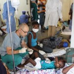 CHOLERA CLINIC — Dr. Ryan Nicholas with Rolling Hills Christian Church tends to one of hundreds of cholera patients in Haiti. About 100 patients came into the clinic each day. Photo by Nick Sharples