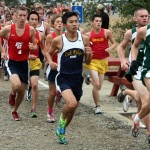 BENJI XIE pulls ahead of the pack during the Delta River League Cross Country Championships Saturday. Xie's first place finish came after passing all other racers in his way during the final 1,200 meter stretch of the 3.1 mile course.