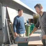 DIY — Homeowner Jeremy Dawson, 39, El Dorado Hills, left, and DIY show host Matt Muenster, 33, prepare a piece of wood for shelving in the master bathroom remodel for the DIY network show Bath Crashers. Village Life photo by Shelly Thorene.