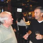 Tony Rogozinski, right, talks with support Rich Downing at the Purple Place on election night. Rogozinski will keep his seat on the El Dorado Hills Community Services District Board of Directors. Village Life photo by Mike Roberts
