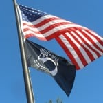 THE POW-MIA FLAG hoisted Wednesday morning reminds Americans not to forget those left behind during foreign wars. Village Life photos by Andy Laughlin