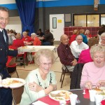 FIRE CHIEF Brian Veerkamp serves up a delicious lunch to Delores Greace, center, and his mother Barbara Veerkamp, far right, during the 2007 Valentine's Day luncheon. Village Life file photo by Mike Roberts