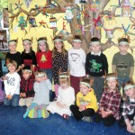 BUSY BEE preschoolers show off big smiles in front of the tree they decorated using homemade popsicle stick decorations. Students are (in no particular order) Drew Beretta, Ethan Farrell, Ryan Fujiwara, Lucero Grant, Gunnar Gooch, Brooke Harmon, Owen Jones, Parker McCarley, Olivia McMahon, Aubrie Miller, Dante Rovetti, Skylar Seivane, Avery Sheridan, Anahita Shojaei, Jake Simkin, Marissa St. Martin, Addison Woods and Nathan Zweber. Village Life photo by Noel Stack