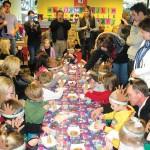 Preschoolers and their parents decorate ice cream cones during Busy Bees Preschool's Christmas celebration Wednesday. Village Life photo by Noel Stack