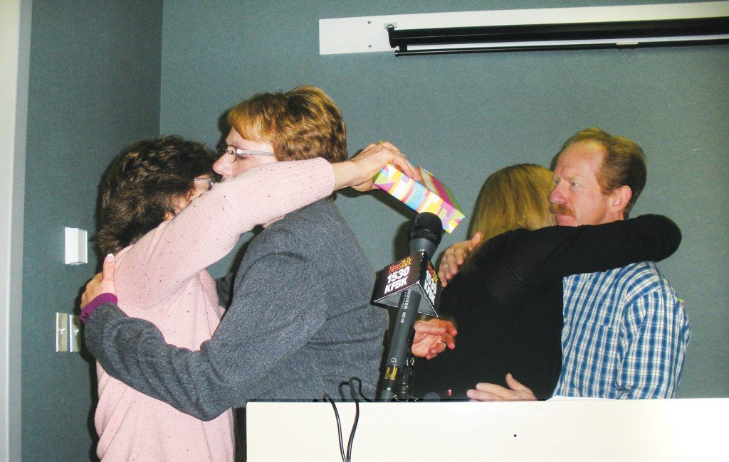 "HUGS ALL AROUND — Cameron Park resident€"" Heidi Napier, far left, accepts a hug from Cindy Lytle while Shannon Beretta, also of Cameron Park, hugs Walt Lytle, the man Napier and Beretta helped save. Cameron Park Life photo by Noel Stack"