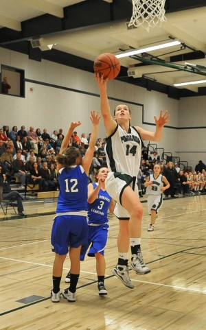 BRUIN ALISON RYAN ends a drive with an outside layup against El Dorado. Mother Lode News photo by Pat Dollins