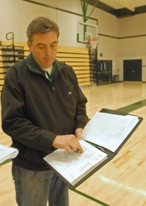 NEW GYMNASIUM — assistant principal Darrin Slojkowski shows the written plans for the newly completed gym renovation at Ponderosa High School. Mother Lode News photo by Shelly Thorene