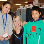 "HAPPY SHOPPERS —€"" Cyndee Pierson spends some time with two lucky kids who participated in the CASA/Big Brothers Big Sisters shopping trip at Town Center's Target on Dec. 4. Courtesy photo"