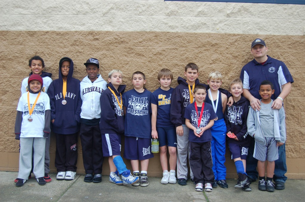 TOUGH GUYS — Members of the El Dorado Hills Wrestling Club pose with their coach Benjamin West, far right. Courtesy photo