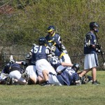 "THE EDHY JV Lacrosse Trojans ""get the goalie"" following their win over the Pleasant Grove Blue Team. Courtesy photo"