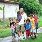 "BUDDIES —€"" Brandon Mecier walks with the children of Nueva Vida. Courtesy photo"