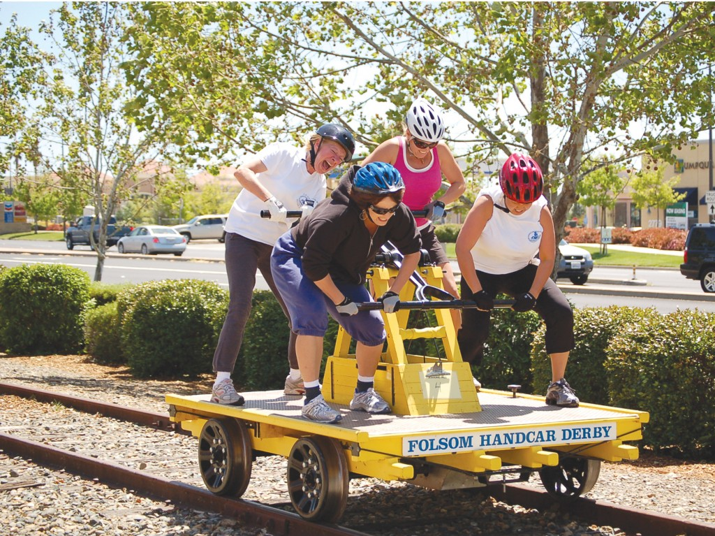 "FULL SPEED AHEAD —€"" A women's team at the Folsom Handcar Derby gives it their all. This year's events take place April 30 and May 1, with a practice session on April 23. Courtesy photo"