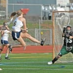 Oak Ridge's No. 15 Megan Lee makes a goal. Village Life photo by Shelly Thorene
