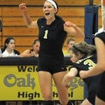 "YES! —€"" Katie Vaughn celebrates a victory at a varsity volleyball game last fall. The Lady Trojans finish thier season with an overall record of 20-17 and Vaughn will continue her volleyball career this fall at Brigham Young University. Village Life file photo by Pat Dollins"