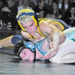 PINNING HIM DOWN — Keaton Subjeck holds onto an opponent at a wrestling match last year. Subjeck finished his sophomore season as the eighth best 145-pounder in the state. Village Life file photo by Pat Dollins