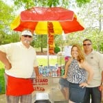 "THE FAMILY STAND —€"" John Koogle his daughter Jennifer Curtsinger and son-in-law William, left to right, enjoy selling hot dogs at local Little League games. They donate a portion fo their proceeds back to the program. Village Life photo by Julie Samrick"