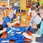 "COLLIE IN THE COMMUNITY —€"" Oak Ridge star reciever Ausin Collie, right, who now plays with the Indianapolis Colts, took time to chat at Rockin' Frog Yogurt with, left to right, Victor and David Rudd, both 12, and Kyle Smith, 14, who won the ""meet and greet"" at Marina Village Middle School. Collie talked about life in the NFL and swapped injury stories with the starstruck middle schoolers. Village Life photo by Mike Roberts"