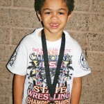 AT 5 YEARS OLD, Scotty Moore has already proven he's a serious wrestler. He bought home a sixth place medal from the the Dave Schultz Kids Freestyle State Tournament. Courtesy photo