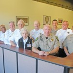 SMILING FACES will greet visitors to the El Dorado Hills sheriff's substation, now staffed by STARs. Left to right, Sheriff John D'Agostini, STAR Jim Singleton, STAR John Cook, STAR John Marchant, STAR Betty Engelhardt, STAR John Bronaugh, Sgt. Wishart, Sgt. Bryan Golmitz, STAR Wes Bean and Undersheriff Rich Williams. Village Life photo by Noel Stack