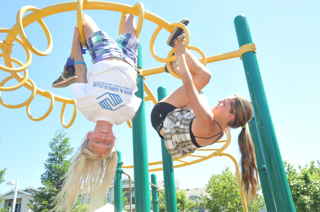 "JUST HANGIN' OUT —€"" Jessica Furtado, 12, left, and Marissa Flickinger, 12, enjoy the jungle gym at the Boys & Girls Club barbeque at White Rock Village. The El Dorado Hills club is open to children ages 5 to 18 through Aug. 5. Village Life photo by Shelly Thorene"