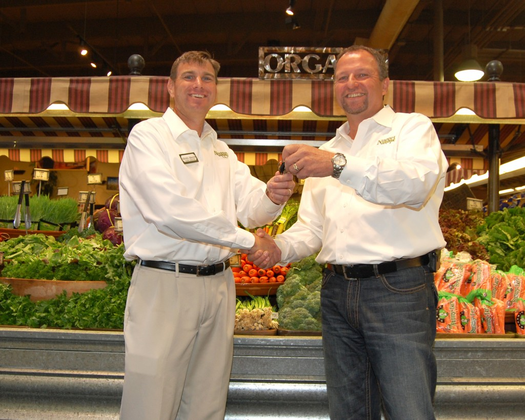 HANDING OVER THE KEYS –— Former Nugget Market Store Director Randy Wehman, right, gives the keys to the El Dorado Hills Store to his replacement, Kraig Brady, left. Wehman will become director of Kitchen Operations, a position Brady has held for the last 12 years. Brady said the job-swap reflects Nugget's corporate culture, and will allow both men to reinvent their positions. Wehman, who lives in Woodland, will spent most of each week traveling between stores in his new role. Village Life photo by Mike Roberts