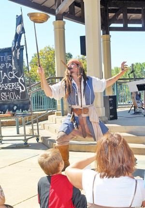 CAPTAIN JACK SPARERIBS, aka Ace Miles, 49, from the Bay Area entertains the crowd gathered at Village Green Park Saturday for the annual pirate invastion, which benefits the El Dorado Hills Library. Village Life photo by Shelly Thorene