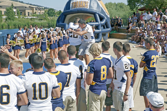 TROJAN FOOTBALL team members greet each other and the crowd in El Dorado Hills Town Center for the Meet The Trojans event on Saturday. Village Life photo by Shelly Thorene