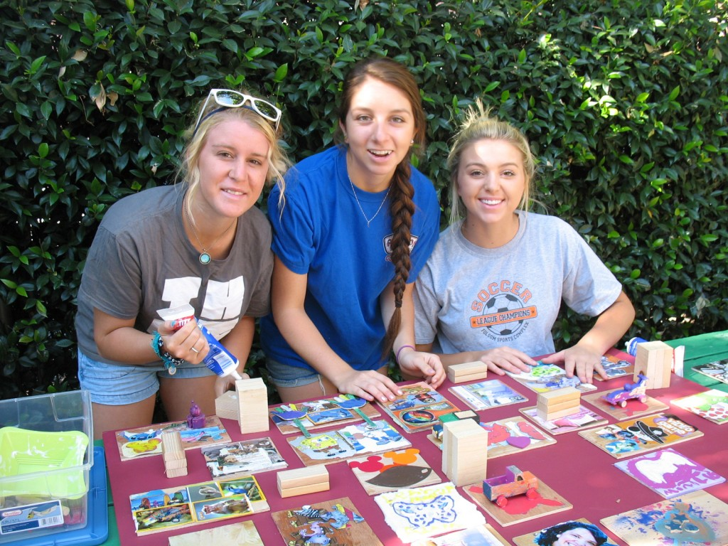 "LOVING IT —€"" Jordynn Wood, Gabby Zeagler and Maddy Hames, left to right, work on the ""Layers of Love"" art project at the Mustard Seed School in Sacramento. Courtesy photo"