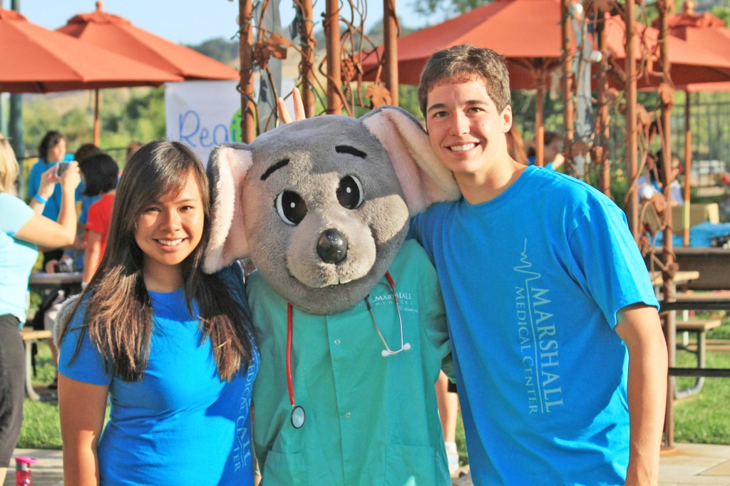MARSHALL junior volunteers Nekaela Edralin and Aaron Downs pose with Marshall Mouse (Sahana A.) at the health expo. Courtesy photo