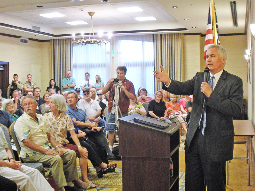 CONGRESSMAN TOM McCLINTOCK takes questions after a rousing speech at the Tea Party Patriots of El Dorado Hills meeting last Wedesday evening. Village Life photo by Noel Stack