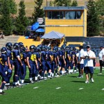 THE FRESHMAN TROJANS line up prior to the start of Thursday evening's game. Photo by Suzanne Hunt