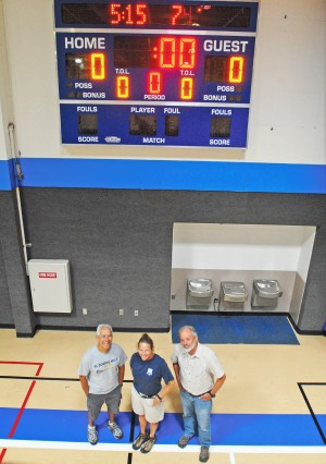 SCORE — EDHCSD Recreation Supervisor Frank Sianez, construction inspector Darrah Ramsbotham and special projects manager Kent Oakley stand under the new scoreboard at the El Dorado Hills CSD gym. Funding for the scoreboard and basketball hoop backboards came from a fundraiser organized by Sianez' wife, Nancy. Village Life photo by Krysten Kellum