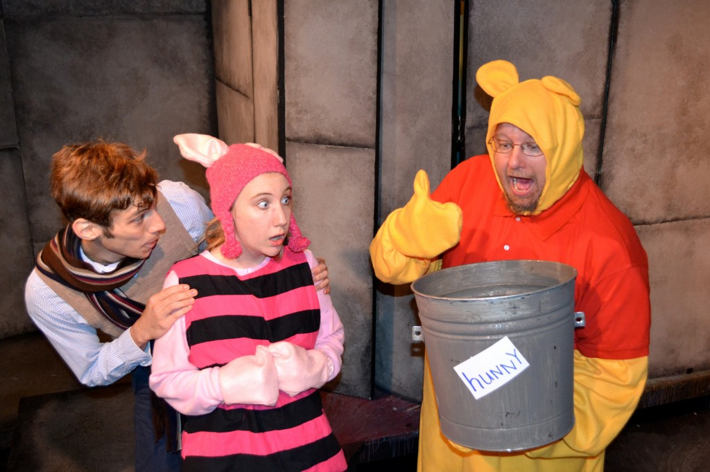 "All gone —€"" Christopher Robin (Benjamin T. Ismail) and Piglet (Andrea Kersten) watch as Pooh (Wade Lucas) panics when he has no hunny in ""A Winnie-the-Pooh Christmas Tail."" Photo by Beth Edwards"