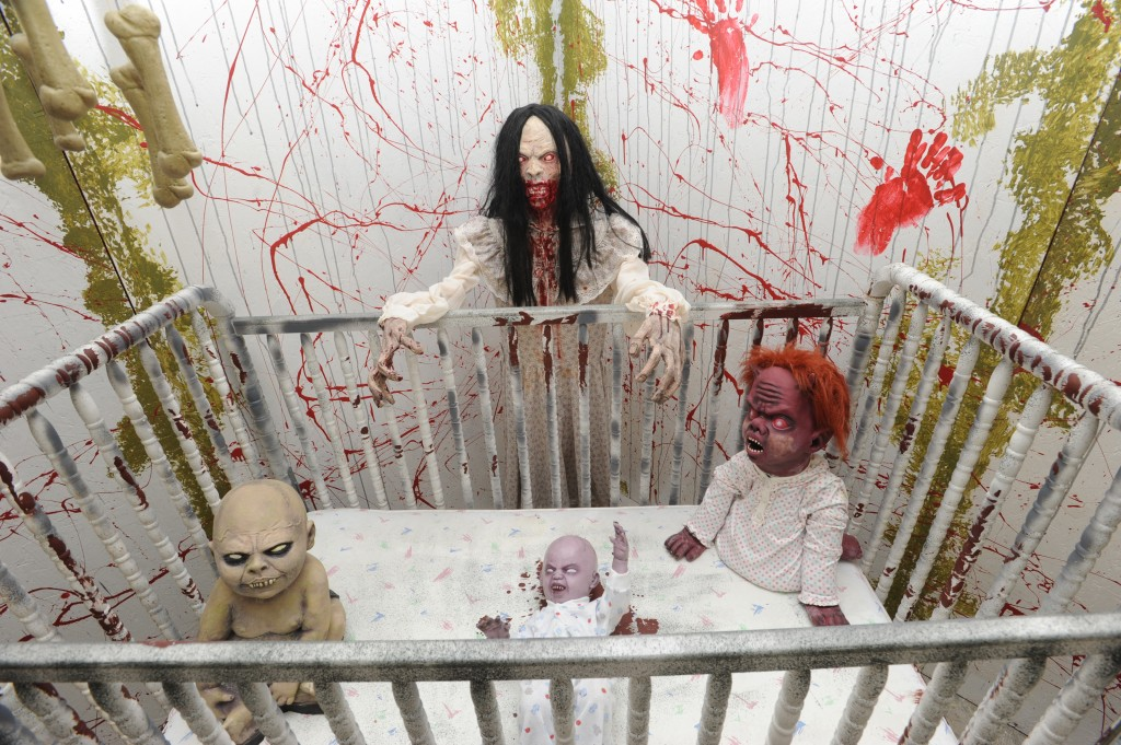 Ghoulish babies haunt the nursery in the Ravenblood Mortuary Haunted House in El Dorado Hills. This house of horrors is open from 7 to 11 p.m. through Halloween. Village Life photo by Shelly Thorene