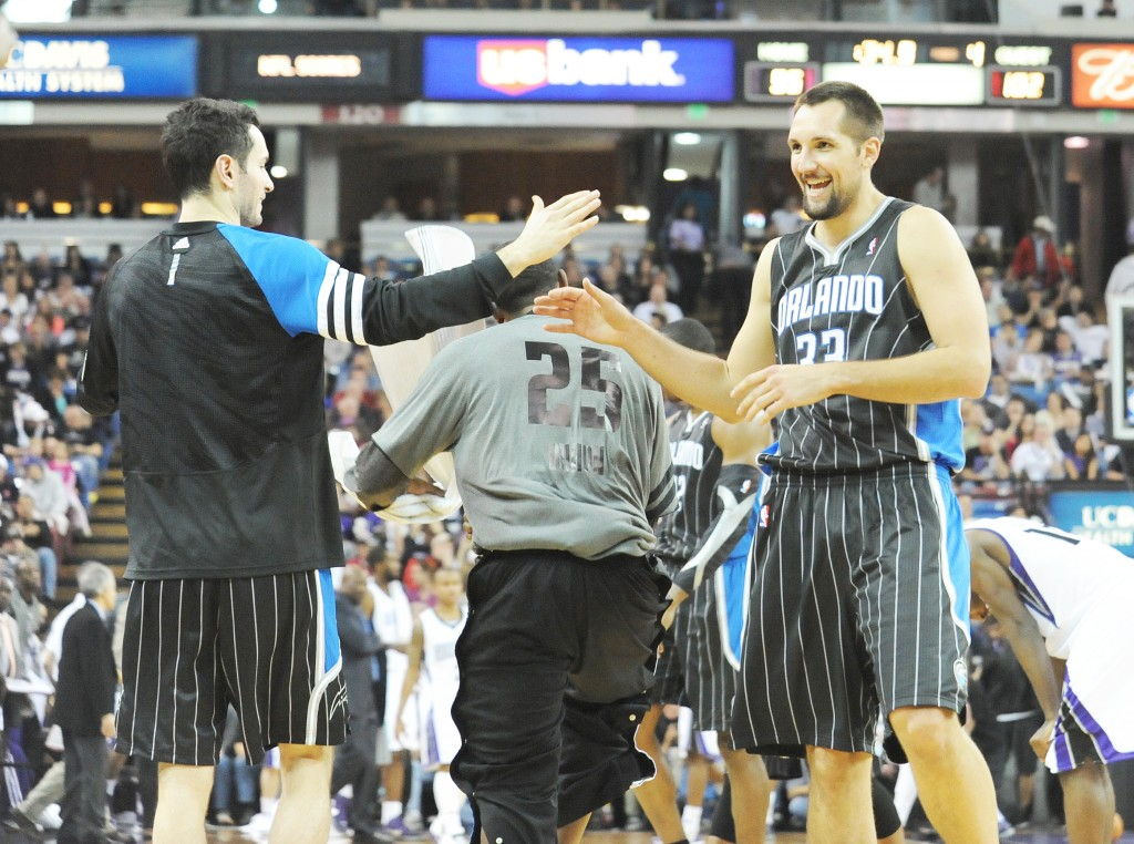 Former Trojan Ryan Anderson, right, congratulates teammate J.J. Redick after the Orlando Magic's win over the Sacramento Kings at Power Balance Pavilion in Sacramento on Sunday. Village Life photo by Shelly Thorene