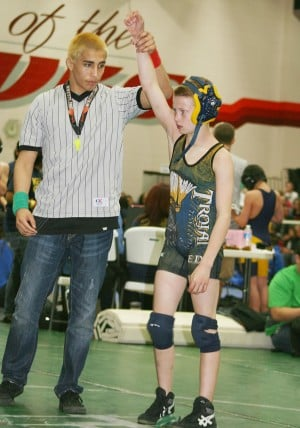 Jackson Redhair is declared the winner at a recent wrestling tournament. Courtesy photo