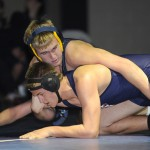 Trojan Eric Rohrer, 184, pins his opponent from Pleasant Grove High School on Wednesday night. Village Life photo by Shelly Thorene