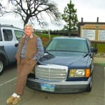 Supervisor John Knight sticks by his classic Mercedes and his record on the board. Village Life photo by Mike Roberts