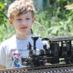 Evan Anderson, 7, watches a steam-powered locomotive. Village Life photo by Pat Dollins