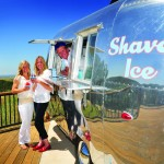 hiverSisters Erin Whiteley, left, and Geneva Soulier, center, enjoy some of their shaved ice goodies with Mason Porter.