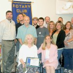 Rotary Club of El Dorado Hills Teacher of the Year Debbie Giannotti, seated holding plaque, is surrounded by family, colleagues, students and Rotarians congratulating her on her success. Village Life photo by Noel Stack
