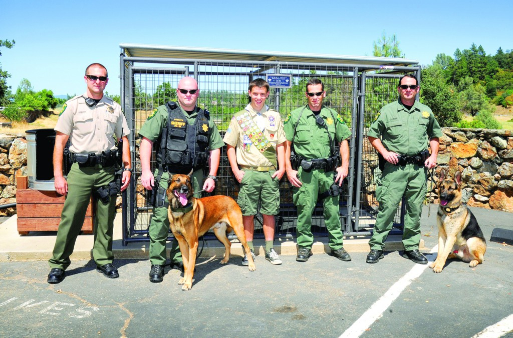 Eagles Scout Tommy Horn of Folsom, center, stands with El Dorado County sheriff's deputies Stephen Coburn, Mike Roberts with Backus, a 6-year-old Belgian malanois, Sean Gillespie and Jeff tucker with Carly, a 20-month-old German shepherd. VIllage Life photo by Pat Dollins