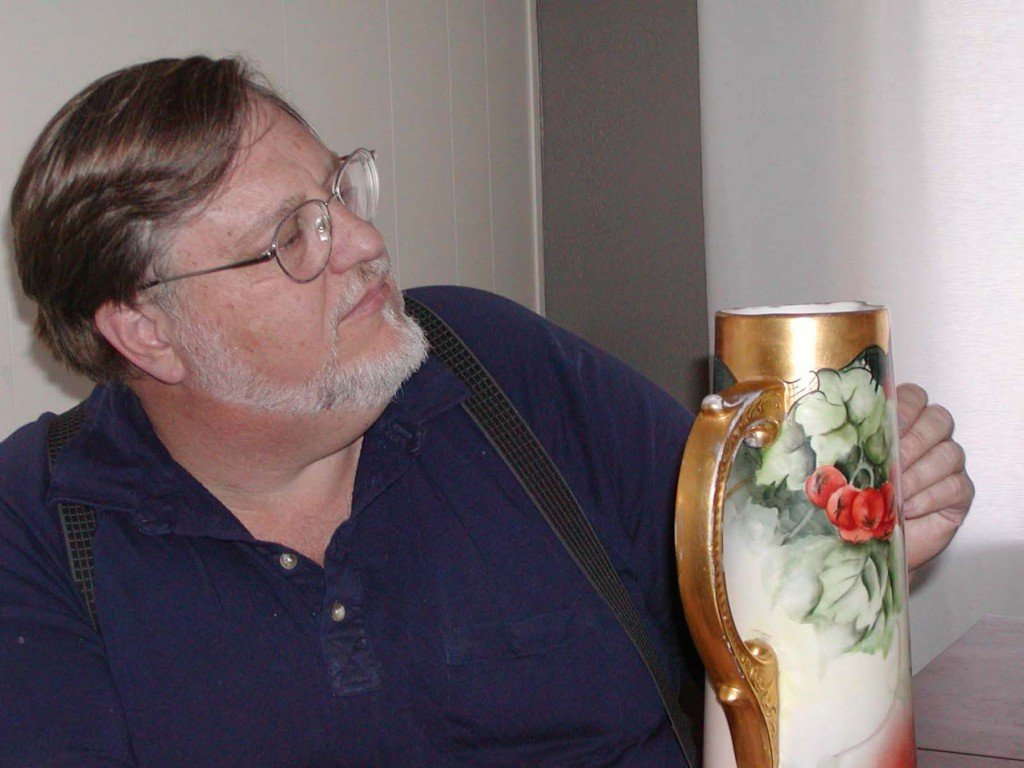 Gary Cox examines a piece during an earlier Antique Evaluation Day. Courtesy photo