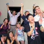"""We did it"" – Members of Foothills Moving Forward celebrate on election night. They made an estimated 10,000 calls to battleground states from their headquarters in the El Dorado Hills Business Park Tuesday, part of the Obama campaign's sophisticated ""ground game,"" deftly executed by thousands of volunteers across the country. The local organization was led by Joni Remer, center-left, hands folded and mouth open. Other celebrants include Robin Carter at left, Lynn Hadjian, seated with mouth agape, Sam Phelan at far right and Daniel Stephenson, right front. Village Life photo by Mike Roberts"