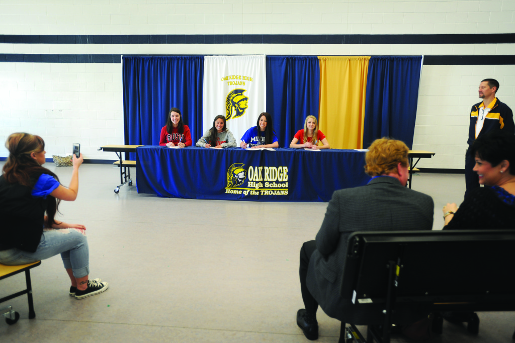 Oak Ridge seniors sign on to play college sports during a ceremony last Wednesday. Village Life photo by Krysten Kellum