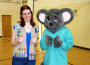 Girl Scout Mandy Price and Marshall Mouse give a thumbs up at Price's health fair. The Girl Scout said she wanted to educate children about the benefits of healthy lifestyles. Courtesy photo